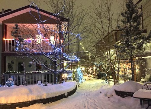 Prairie Sky with snow and lights: The outer courtyard of Prairie Sky in winter.