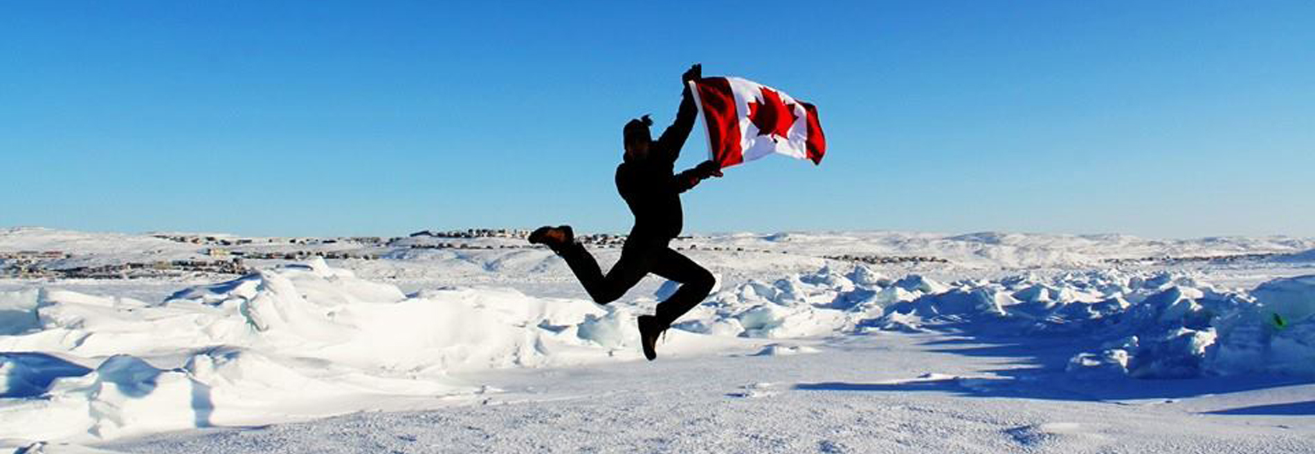 Canada 300 actor Eloi Homier celebrates the anniversary of the Canadian Flag after performance in Iqaluit. Photo by Raychel Reimer.
