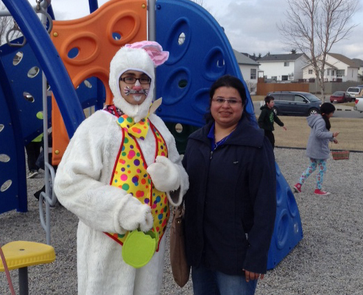 Syeda poses with the celebrity of the gathering, the Easter bunny.